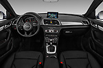 Stock photo of straight dashboard view of a 2018 Audi Q3 Premium 5 Door SUV