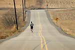 Jogger on country road.