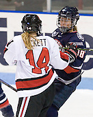 Casey Pickett (NU - 14), Rebecca Hewett (UConn - 18) - The visiting University of Connecticut Huskies defeated the Northeastern University Huskies 4-2 (EN) in NU's senior game on Saturday, February 19, 2011, at Matthews Arena in Boston, Massachusetts.
