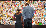 Family members and friends of victims gather in front of a 'hedge of compassion' , made of thousands of dolls , during a commemoration ceremony for the victims of flight MH17 in Nieuwegein, near the central city of Utrecht, the Netherlands, Friday, July 17, 2015. REUTERS/Michael Kooren/Pool