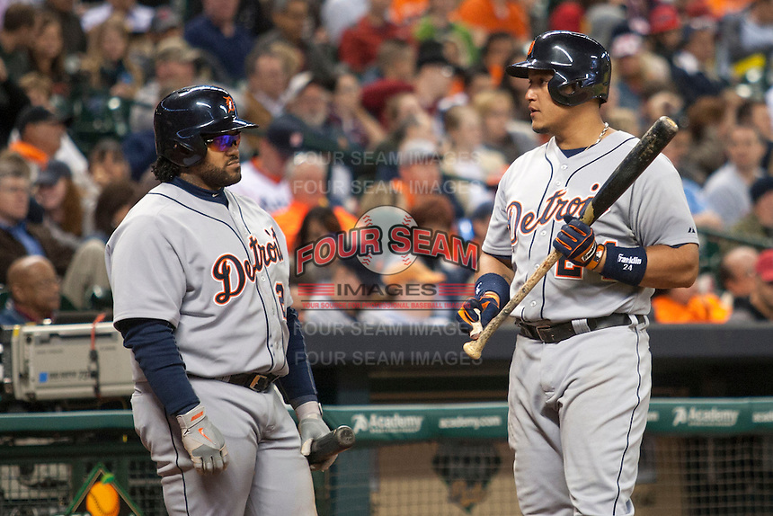 Detroit Tigers third baseman Miguel Cabrera (24) talks with first baseman Prince Fielder (28) during the MLB baseball game against the Houston Astros on May 3, 2013 at Minute Maid Park in Houston, Texas. Detroit defeated Houston 4-3. (Andrew Woolley/Four Seam Images).