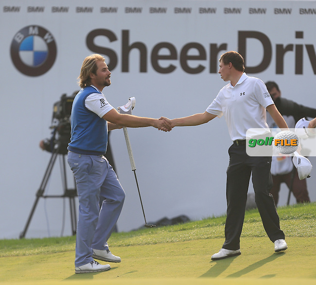 Victor Dubuisson (FRA) and Matthew Fitzpatrick (ENG) on the 18th green during Round 4 of the BMW Masters at Lake Malaren Golf Club in Boshan, Shanghai, China on Sunday 15/11/15.<br /> Picture: Golffile | Thos Caffrey<br /> <br /> All photo usage must carry mandatory copyright credit (&copy; Golffile | Thos Caffrey)