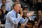 March 6, 2015; Las Vegas, NV, USA; Loyola Marymount Lions head coach Mike Dunlap instructs against the Santa Clara Broncos during the first half of the WCC Basketball Championships at Orleans Arena.