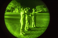 Hunting guide Larry Hromadka instructs mother Joan Schaan and son Daniel Schaan, 15 how to use their night-vision hunting eyewear at the Ox Ranch on 17th of August, 2017 in Uvalde, Texas, USA. <br /> Photo Daniel Berehulak for the New York Times