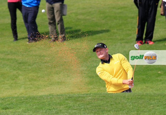 Jamie Donaldson (WAL) chips from a bunker at the 9th green during Saturday's Round 3 of the 2013 BMW Masters presented by SRE Group held at Lake Malaren Golf Club, Shanghai, China. 26th October 2013.<br /> Picture: Eoin Clarke/www.golffile.ie