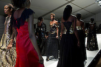 HARARE, ZIMBABWE - SEPTEMBER 26: Models walk for the Tanzanian  based designer Mustafa Hassanali during a fashion show on September 26, 2014 at the Harare City library in Harare, Zimbabwe. Local and African and based designers showed their collections during the 5th edition of Zimbabwe Fashion week (Photo by: Per-Anders Pettersson)