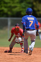 St. Louis Cardinals Oscar Mercado (11) tags out Milton Ramos (7) during a minor league spring training game against the New York Mets on April 1, 2015 at the Roger Dean Complex in Jupiter, Florida.  (Mike Janes/Four Seam Images)