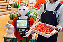 The humanoid robot Pepper debuted as a new member of staff at the ''Tottori Okayama Shimbashi-kan'' store on July 1, 2015, Tokyo, Japan. The robot developed by SoftBank Corp. is programmed to interact with people and it is claimed that it can provide reception services in commercial establishments. Pepper will introduce the store's products and services to customers as a special employee for two days. The Tottori Okayama Shimbashi-kan sells unique food and traditional handicraft products from Tottori and Okayama prefectures in western Japan. (Photo by Rodrigo Reyes Marin/AFLO)