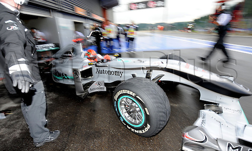 German driver Michael Schumacher of Mercedes GP drives his car out of the box during qualifying at Spa-Francorchamps Circuit near Spa, Belgium