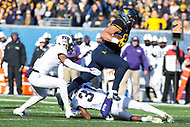Morgantown, WV - November 10, 2018: West Virginia Mountaineers tight end Trevon Wesco (88) leaps over a TCU Horned Frogs defender during the game between TCU and WVU at  Mountaineer Field at Milan Puskar Stadium in Morgantown, WV.  (Photo by Elliott Brown/Media Images International)