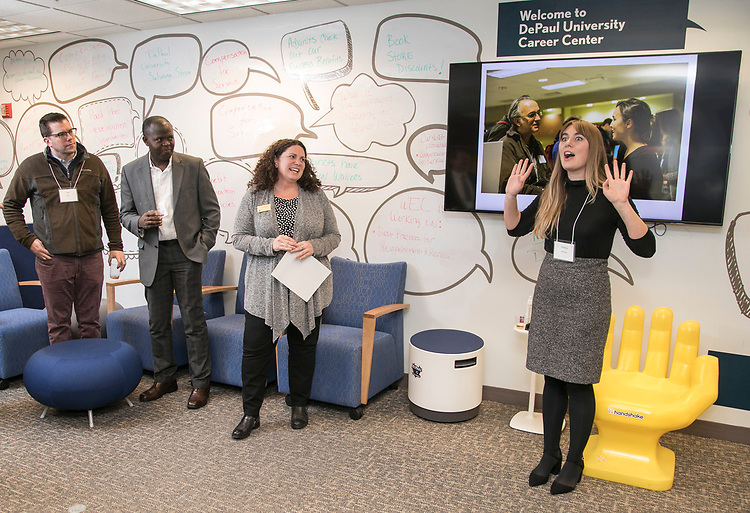 Victoria Hohenzy, chair of the Workplace Environment Committee (WEC), right, greets her fellow adjunct faculty members and thanks the staff of the Career Center during a networking reception, Monday, March 5, 2018, in the center's Loop Campus office. The event, hosted by the Workplace Environment Committee (WEC), offered participants the opportunity to meet fellow adjunct faculty members and learn about the many resources available through the Career Center. (DePaul University/Jamie Moncrief)
