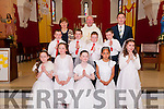 1st Communion: Pupils from Ballylongford NS & Lenamore NS who received their 1st Commmunion at Ballylongford Church on Saturday morning last. Front : Krystal Keane, Kayleigh Swanser, Abbie Collins, Sorcha Cameron & Eimear O'Shea. Middle : Sean O'Connor, Jason Ahern, Liam Walsh & Christopherb Higgins, Back : Mrs. Ann Marie O'Keeffe, Lenamore NS, Fr. Pardraigh Kennelly & Mr. Kevin Stack, Ballylongford NS.