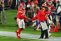 2nd February 2020, Miami Gardens, Florida, USA;   Kansas City Chiefs Quarterback Patrick Mahomes (15) shakes hands with Kansas City Chiefs offensive coordinator Eric Bieniemy after scoring a touchdown  during the first quarter of Super Bowl LIV on February 2, 2020 at Hard Rock Stadium in Miami Gardens