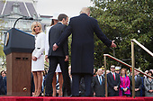 United States President Donald J. Trump, first lady Melania Trump, President Emmanuel Macron and Mrs. Brigitte Macron of France depart the podium during a state visit to The White House in Washington, DC, April 24, 2018. Credit: Chris Kleponis / Pool via CNP