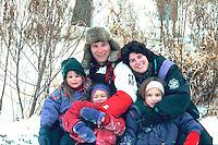 Family having fun at Bracket Park after ice skating age 35 and 4 through 7.  Minneapolis  Minnesota USA