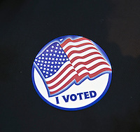 """Fairfax, VA,November 8, 2016, USA:   Polling sites in Fairfax, VA are open and voters are making their voices heard in the 2016 Presidential elections.Voters show off their """"I Voted"""" sticker.  Patsy Lynch/MediaPunch"""