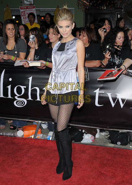 "ANNALYNNE McCORD.Premiere of ""Twilight"" held at The Mann's Village Theatre in Westwood, California, USA..November 17th, 2008.full length black boots fishnet stockings silver top dress skirt silk satin blue purple.CAP/DVS.©Debbie VanStory/Capital Pictures."