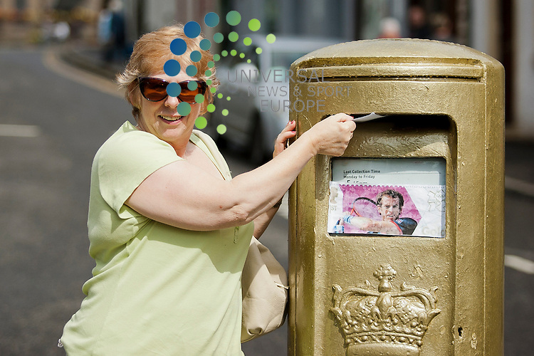 Margaret Ann Smith from Dunblane posts a letter at a post box painted gold to celebrate Andy Murray's win at the London 2012 Olympic Games. Monday, August 06, 2012.  ..Picture: Malcolm McCurrach, Universal News and Sport (Europe) - 06/08/2012