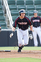 Trey Michalczewski (27) of the Kannapolis Intimidators hustles down the first base line against the Hagerstown Suns at CMC-Northeast Stadium on June 1, 2014 in Kannapolis, North Carolina.  The Intimidators defeated the Suns 5-1 in game one of a double-header.  (Brian Westerholt/Four Seam Images)