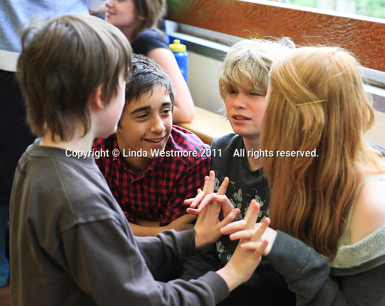 """Enjoying a break.  The Yvonne Arnaud Youth Theatre rehearsing """"The Lion, the Witch and the Wardrobe"""", Guildford, Surrey."""