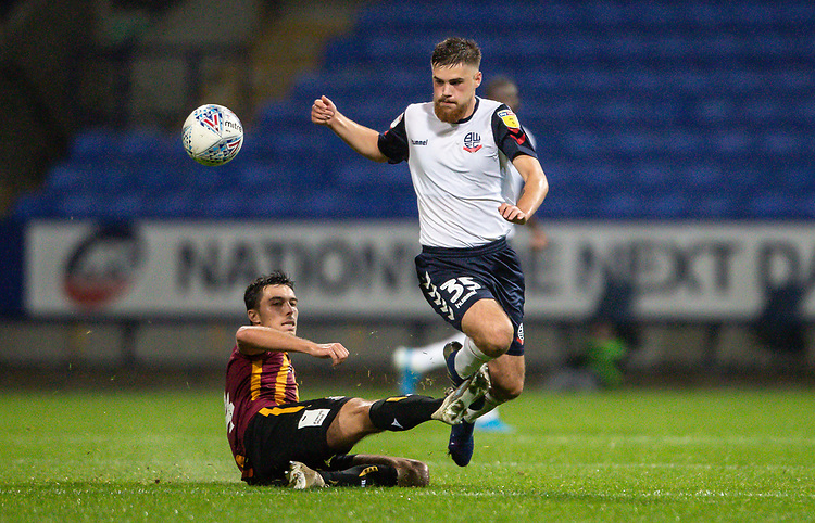 Bolton Wanderers' Sonny Graham competing with Bradford City's Danny Devine <br /> <br /> Photographer Andrew Kearns/CameraSport<br /> <br /> EFL Leasing.com Trophy - Northern Section - Group F - Bolton Wanderers v Bradford City -  Tuesday 3rd September 2019 - University of Bolton Stadium - Bolton<br />  <br /> World Copyright © 2018 CameraSport. All rights reserved. 43 Linden Ave. Countesthorpe. Leicester. England. LE8 5PG - Tel: +44 (0) 116 277 4147 - admin@camerasport.com - www.camerasport.com
