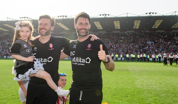 Lincoln City's assistant manager Nicky Cowley, left, and Lincoln City manager Danny Cowley celebrate after winning the league<br /> <br /> Photographer Chris Vaughan/CameraSport<br /> <br /> The EFL Sky Bet League Two - Lincoln City v Tranmere Rovers - Monday 22nd April 2019 - Sincil Bank - Lincoln<br /> <br /> World Copyright © 2019 CameraSport. All rights reserved. 43 Linden Ave. Countesthorpe. Leicester. England. LE8 5PG - Tel: +44 (0) 116 277 4147 - admin@camerasport.com - www.camerasport.com