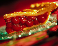 Slice of cherry pie; a delicious dessert served on a plate.