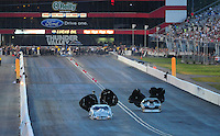 Jun. 19, 2011; Bristol, TN, USA: NHRA pro mod driver Melanie Troxel (left) after defeating Danny Rowe in the final round to win the Thunder Valley Nationals at Bristol Dragway. Mandatory Credit: Mark J. Rebilas-