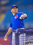 4 April 2015: Toronto Blue Jays first base coach Tim Leiper tosses batting practice prior to a pre-season exhibition game against the Cincinnati Reds at Olympic Stadium in Montreal, Quebec, Canada. The Blue Jays defeated the Reds 9-1 in the second of two MLB weekend exhibition games. Mandatory Credit: Ed Wolfstein Photo *** RAW (NEF) Image File Available ***