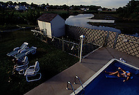 Living on the edge of the wetlands where backyard fences are more to keep wildlife out than to keep family pets in.  This family in Secaucus shares their pool with neighborhood egrets ducks, turtles and muskrats from time to time.