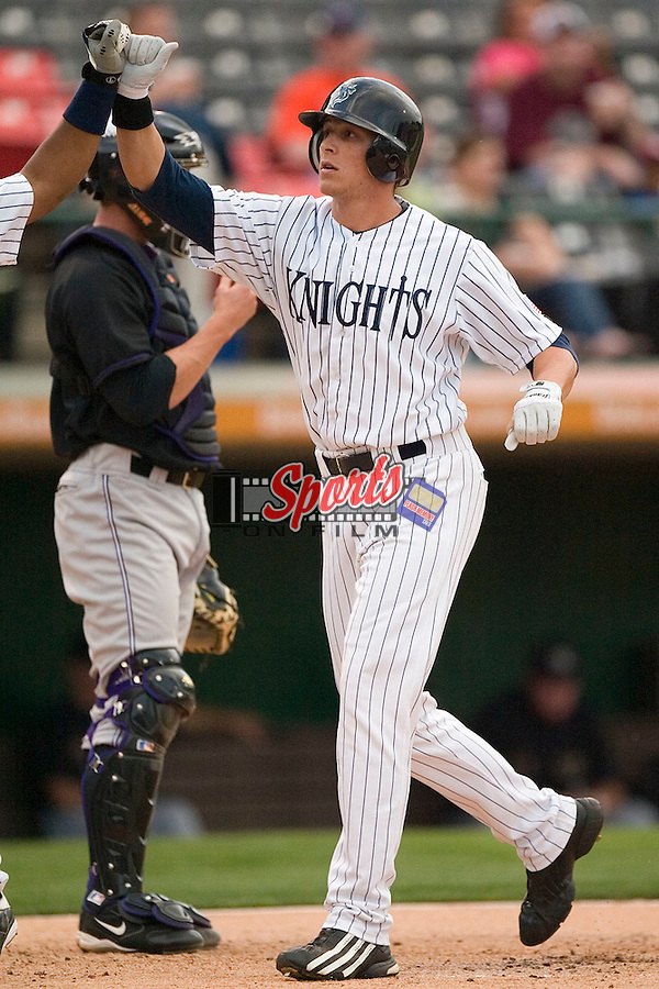 Charlotte Knights outfielder Ryan Sweeney high fives a teammate following his first inning 2-run home run versus the Louisville Bats at Knights Stadium in Fort Mill, SC, Thursday, May 4, 2006.