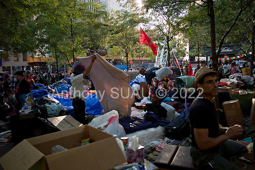 New York, New York<br /> October 7, 2011<br /> <br /> &quot;Occupy Wall Street&quot; protesters encampment at Zuccotti Park expanses and grows by the day. Food, medicine and blankets are seen piled up from donations within the camp and the age range widens.<br /> <br /> The participants of the event, that began on September 17, are mainly protesting against social and economic inequality, corporate greed, and the influence of corporate money and lobbyists on government, among other concerns.