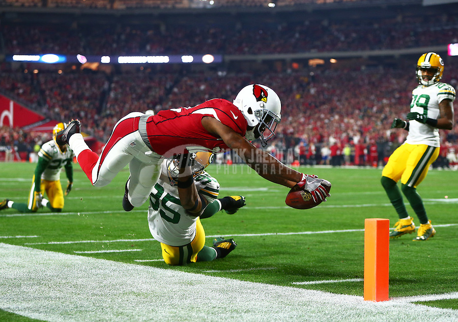 Jan 16, 2016; Glendale, AZ, USA; Arizona Cardinals wide receiver John Brown (12) dives for the pylon against Green Bay Packers defensive end Datone Jones (95) during the third quarter in a NFC Divisional round playoff game at University of Phoenix Stadium. Mandatory Credit: Mark J. Rebilas-USA TODAY Sports