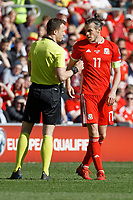 (L-R) Referee Felix Zwayer speaks to Gareth Bale of Wales during the UEFA EURO 2020 Qualifier match between Wales and Slovakia at the Cardiff City Stadium, Cardiff, Wales, UK. Sunday 24 March 2019