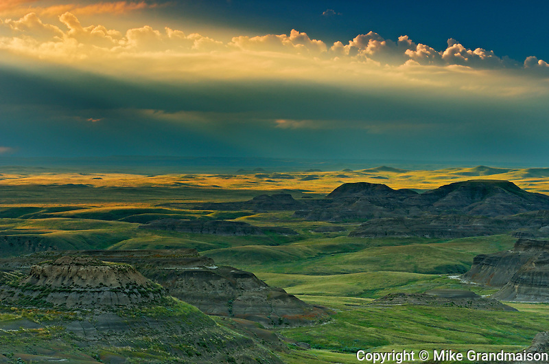Killdeer Badlands at sunset with approaching storm. East Block.<br /> Grasslands National Park<br /> Saskatchewan<br /> Canada