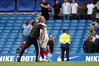 Lys Mousset of Sheffield United gets a hug for his efforts during the Premier League match between Chelsea and Sheff United at Stamford Bridge, London, England on 31 August 2019. Photo by Carlton Myrie / PRiME Media Images.