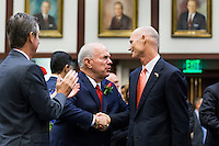 TALLAHASSEE, FLA. 3/3/15-Gov. Rick Scott, right, greets Sen. Alan Hays, R-Umatilla, left, as he enters the House Chamber to give the State of the State Address during the opening day of the 2015 Legislative Session Tuesday at the Capitol in Tallahassee.<br /> <br /> COLIN HACKLEY PHOTO