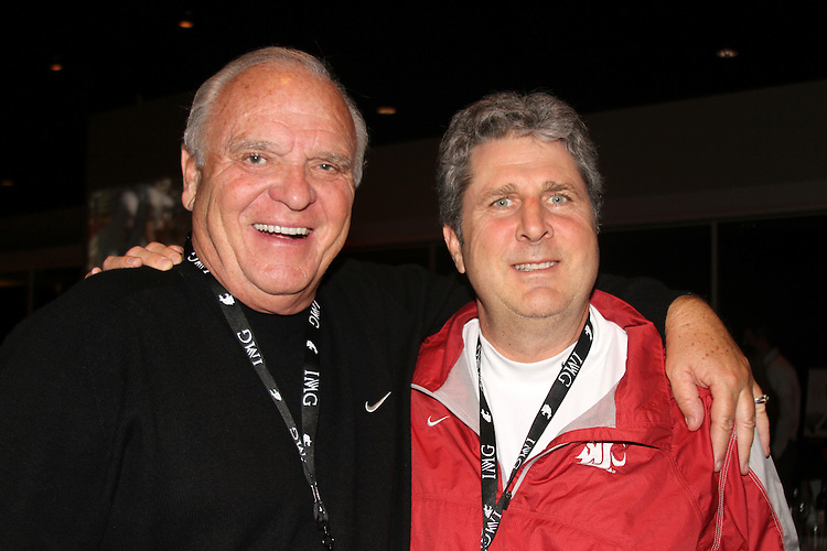 "Former Washington State head football coach, Mike Price (left), and current Cougar head football coach, Mike Leach, pause for a photograph during Washington State University's ""Cougar Legends"" weekend at the Coeur d'Alene Resort in Coeur d'Alene, Idaho, on June 8-9, 2012."