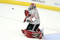 UNO goalie John Faulkner watches as the puck rebounds off him after making a save during the first period. Denver beat Nebraska-Omaha 4-2 Saturday night at Qwest Center Omaha. (Photo by Michelle Bishop)