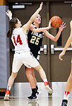 WOLCOTT CT. 10 December 2018-121018SV06-#25 Ava DeLucia of Woodland High tries to pass as #14 Morgan Matyoka of Wolcott High defends during 2nd quarter NVL basketball action in Wolcott Monday.<br /> Steven Valenti Republican-American