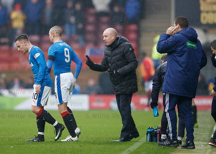 Mark Warburton on the pitch during a break in play changing things around