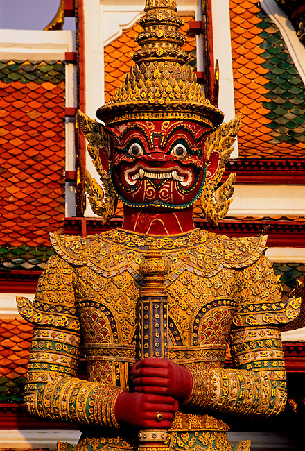 Guardian at base of gilded chedi at Wat Phra Si Ratana Sasadaram (Wat Phra Kaeo), Bangkok, Thailand, Asia