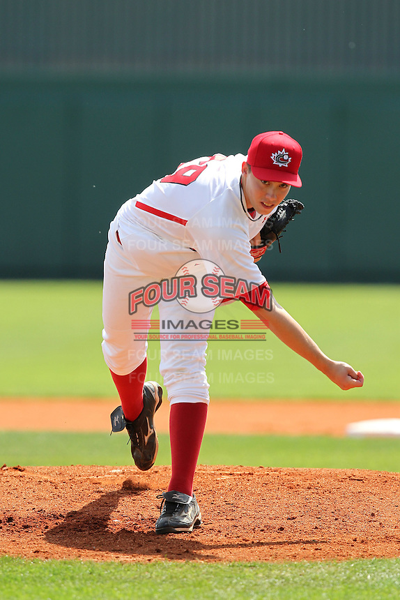 Team Canada Tom Robson #29 delivers a pitch during an exhibition game vs. the Toronto Blue Jays at Al Lang Field in St. Petersburg, Florida;  March 4, 2011.  Toronto defeated Team Canada 9-0.  Photo By Mike Janes/Four Seam Images