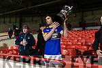 Kerry Captain Killian Young raises the McGrath cup after Kerry Defeated Limerick at the Gaelic Grounds on Sunday.
