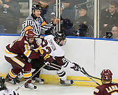 Jake Hendrickson (Duluth - 15), Scott Hansen, John Simpson (Union - 23) - The University of Minnesota-Duluth Bulldogs defeated the Union College Dutchmen 2-0 in their NCAA East Regional Semi-Final on Friday, March 25, 2011, at Webster Bank Arena at Harbor Yard in Bridgeport, Connecticut.