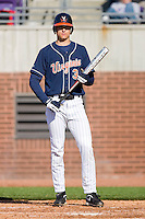 Jarrett Parker #3 of the Virginia Cavaliers looks for a sign from his third base coach before stepping into the batters box at Clark-LeClair Stadium on February 20, 2010 in Greenville, North Carolina.   Photo by Brian Westerholt / Four Seam Images