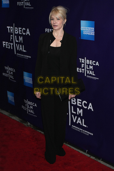 "ELLEN BARKIN .attending the 2010 Tribeca Film Festival Premiere of ""Letters to Juliet"" at the SVA Theatre, New York, NY, USA, .April 25th, 2010..full length black trousers top jacket clutch bag .CAP/LNC/TOM.©LNC/Capital Pictures."
