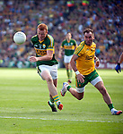 Johnny Buckley with the ball in the All-Ireland Football Final against Donegal in Croke Park 2014.<br /> Photo: Don MacMonagle<br /> <br /> <br /> Photo: Don MacMonagle <br /> e: info@macmonagle.com