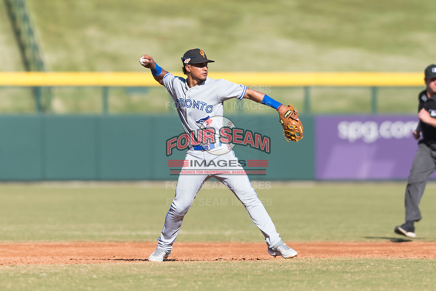 Surprise Saguaros shortstop Santiago Espinal (6), of the Toronto Blue Jays organization, throws to first base during an Arizona Fall League game against the Mesa Solar Sox at Sloan Park on November 15, 2018 in Mesa, Arizona. Mesa defeated Surprise 11-10. (Zachary Lucy/Four Seam Images)