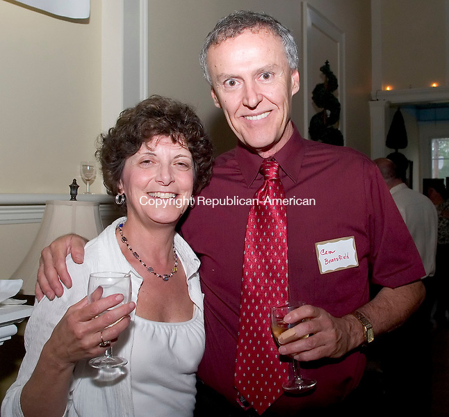 WATERBURY, CT -01 JUNE 06- 060106JT08-<br /> Donna DiCamillo, of Naugatuck, with Cam Bransfield of Torrington at a reception at the Seven Angels Theater in Waterbury to recognize and thank this season's donors, corporate sponsors, and supporters on Thursday, June 1. During the reception Edwin F. Couch received a special dedication for his work at the theater. The theater also announced that the Leever Foundation is providing a $10,000 grant to go towards the purchase of computers and software in the box office that would allow for tickets to be bought on the internet. The entire project costs $19,000, and the remaining $9,000 will be raised by the theater.<br /> Josalee Thrift Republican-American